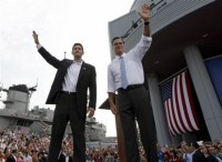 Mitt Romney and Paul Ryan greet an enthusiastic crowd of supporters at a campaign rally.