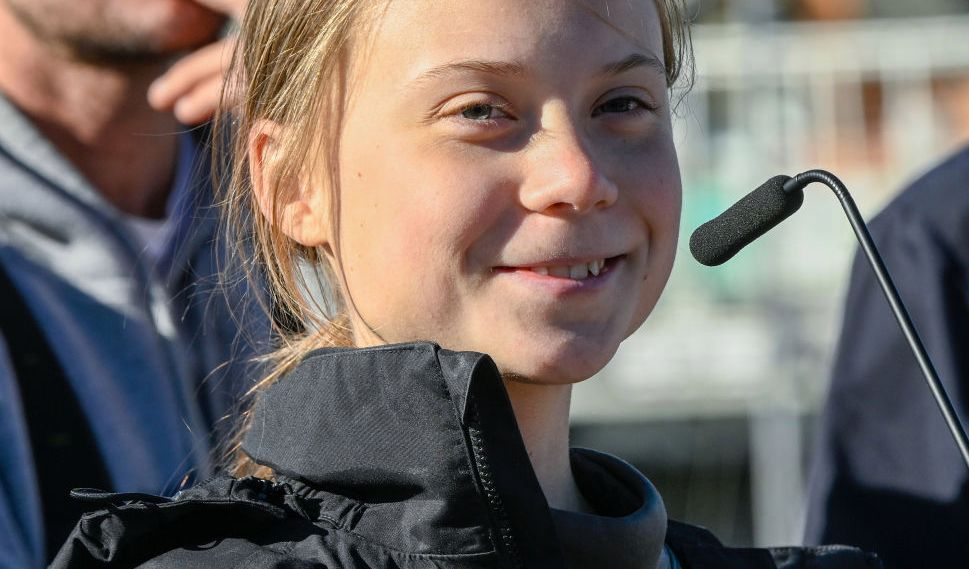 LISBON, PORTUGAL - DECEMBER 03: Swedish teen climate activist Greta Thunberg addresses supporters and journalists upon her arrival in Santo Amaro Recreation dock on December 03, 2019 in Lisbon, Portugal. Greta Thunberg sailed from Norfolk, Virginia, USA , accompanied by her father Svante Thunberg on the French built Outremer 45 catamaran La Vagabonde, skippered by Australian Riley Whitelum, and is on her way to attend COP25 in Madrid, Spain. (Photo by Horacio Villalobos/Getty Images)