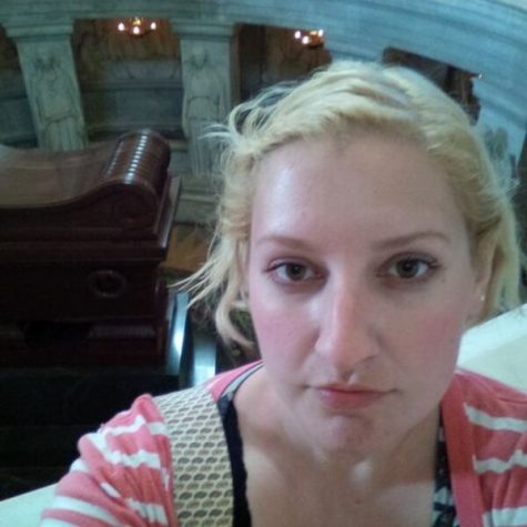 The French teacher Miss Donathan pictured in Paris, France at Napoleons tomb.