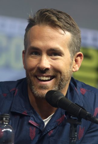 Ryan Reynolds the actor for Guy, the main character of Free Guy, pictured at a comic con panel.