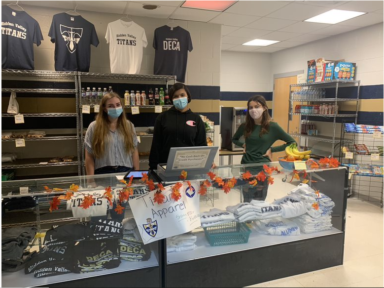 Aidan Franklin (grade 12), Hannah Cooper (grade 12), and Fayrin Mitchum (grade 9) working in the school store.